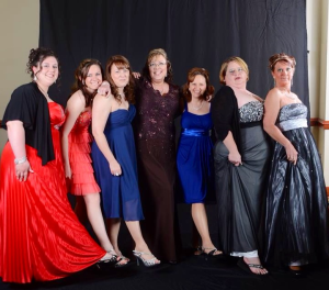 That's me in the center. Out of scrubs and into a gown. :)